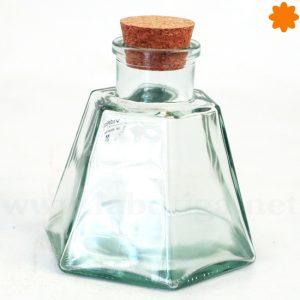 Tarro pequeñito de cristal con forma hexagonal y tapón de corcho