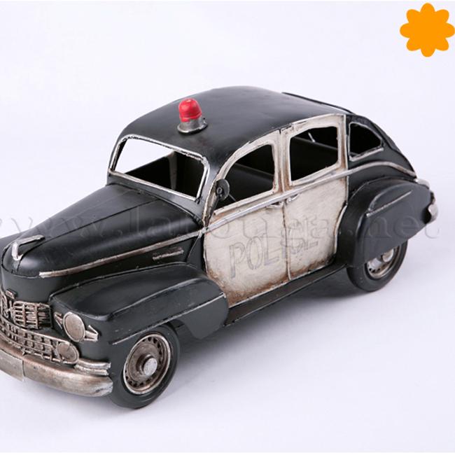 Figura de metal Coche de policía antiguo