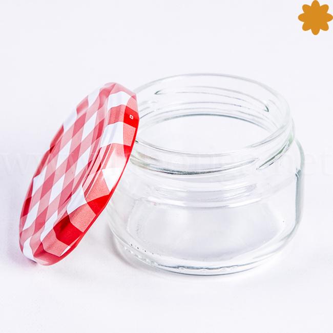Tarro de cristal pequeñito con tapa enroscada de rayas rojas y blancas