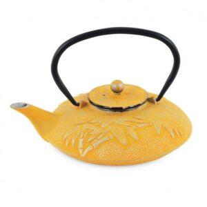 Tetera de hierro colado de color amarilla y plateada